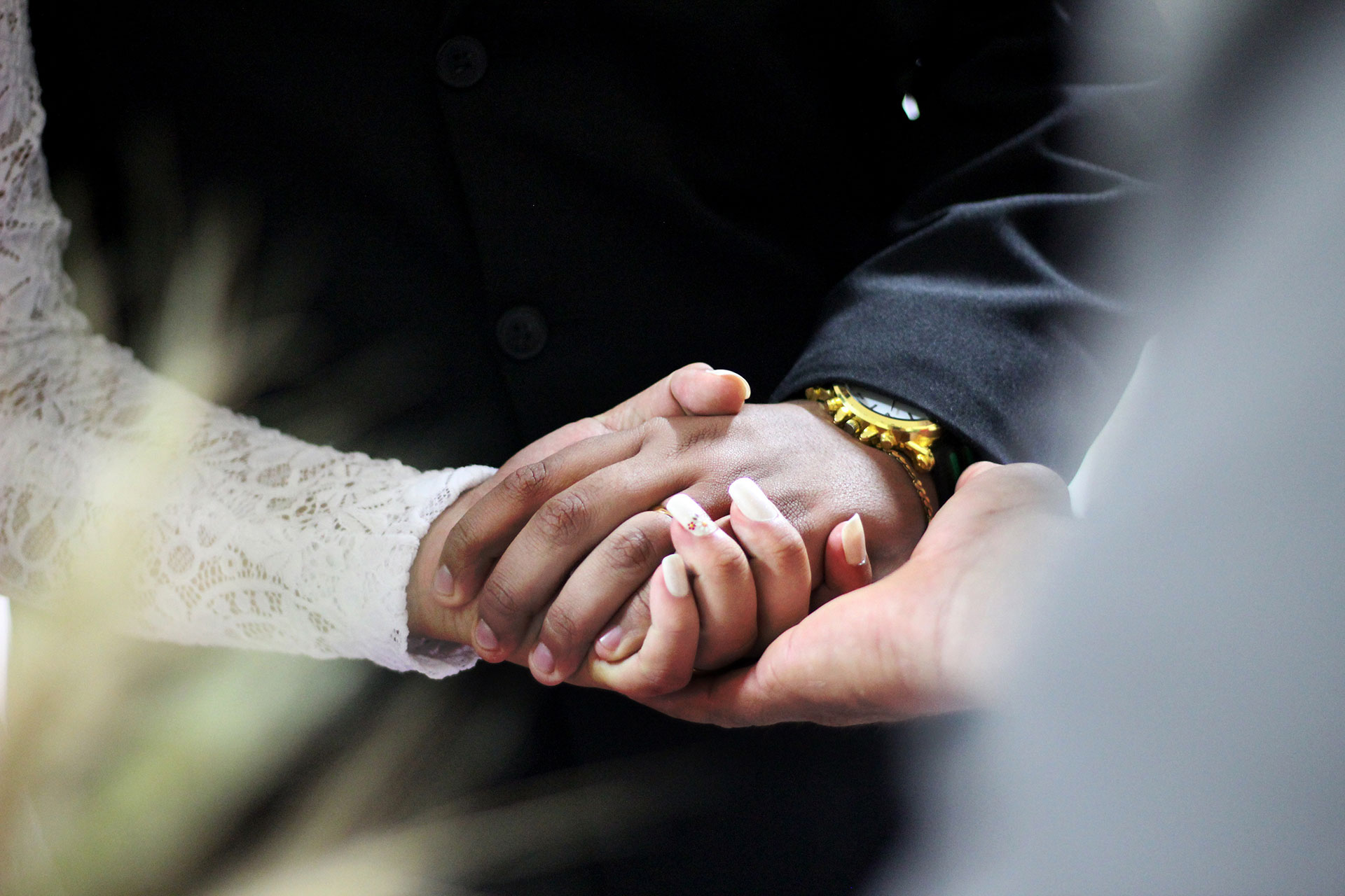 photo of wedding couple's hands